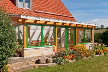 Wohngarten mit Glasdach und Holz-Alu Fenster